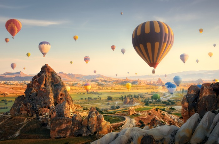 hot-air-balloons-flying-at-sunset-cappadocia-turkey-picture-id1164258121